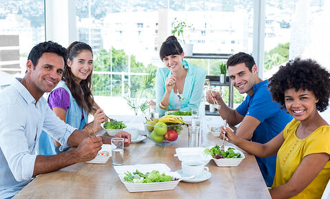 Young business people having lunch together
